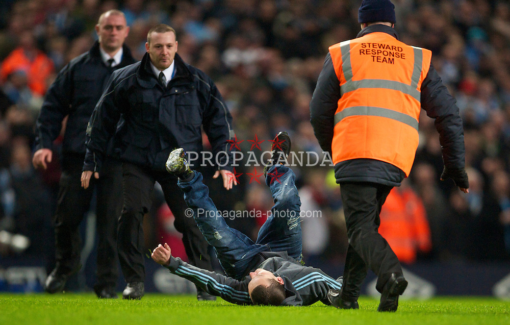 MANCHESTER, ENGLAND - Tuesday, January 18, 2011: A Manchester City supporter invades the pitch during the FA Cup 3rd Round Replay match against Leicester City at the City of Manchester Stadium. (Photo by David Rawcliffe/Propaganda)