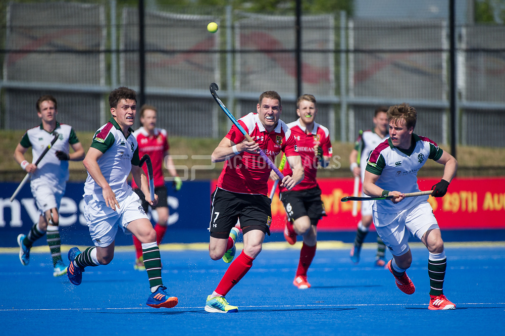Holcombe's Gareth Andrews chases the ball. Holcombe v Surbiton - Semi-Final - Men's Hockey League Finals, Lee Valley Hockey & Tennis Centre, London, UK on 22 April 2017. Photo: Simon Parker