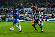 Chelsea FC Oscar on the attack against Newcastle United Fabricio Coloccini during the Barclays Premier League match between Newcastle United and Chelsea at St. James's Park, Newcastle, England on 26 September 2015. Photo by Craig McAllister.