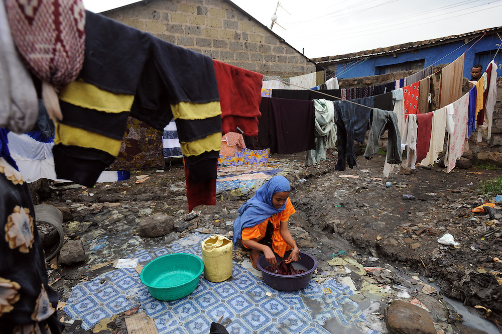 Fortun Abdi Said (16) washes clothes in the Somali suburb of Eastleigh in Nairobi, Kenya 6/7/2008