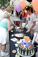 Folks gets samples from ele's Cake Co. during the 21st annual The Taste in the Lincoln Park Commons area at the Fraze Pavilion, Thursday, September 3, 2009.