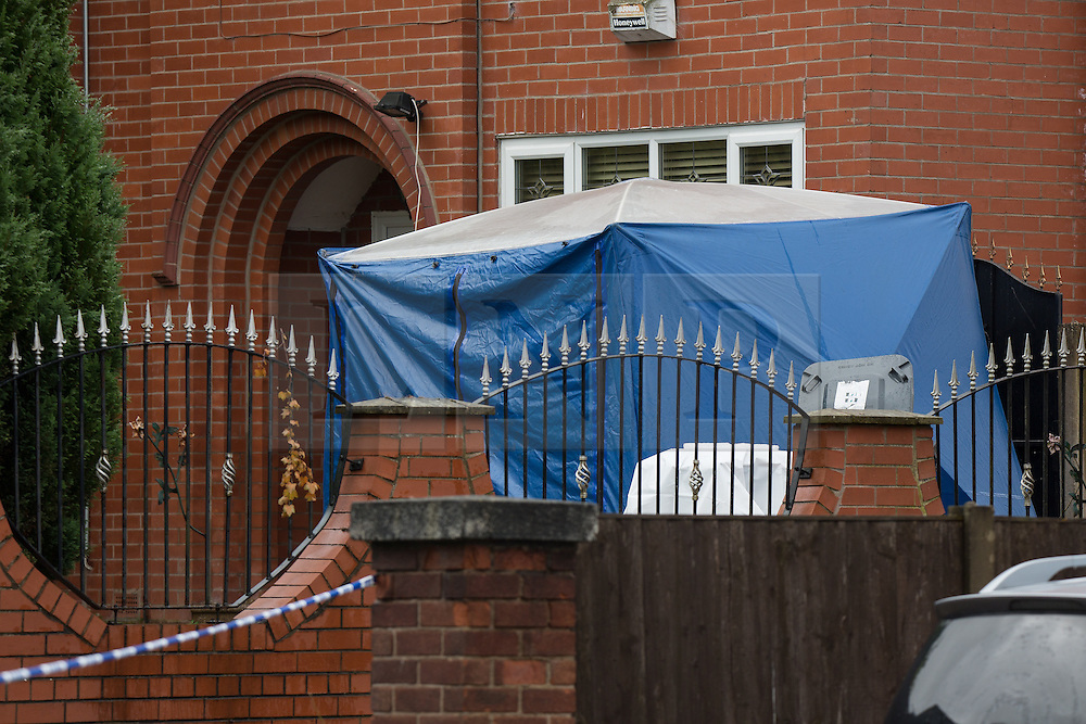"""© Licensed to London News Pictures. 27/07/2015. Salford, UK. Scene of the home of Paul Massey on Manchester Road , Clifton , Salford where Paul Massey - known as Salford's """"Mr Big"""" was shot dead last night (26th July 2015 ) . Photo credit: Joel Goodman/LNP"""