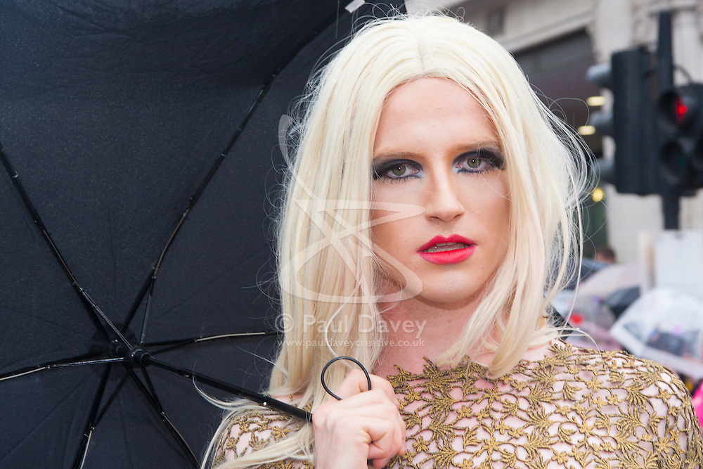 London, June 28th 2014. A transexual gazes into the camera as the Pride London parade proceeds through the city's streets.