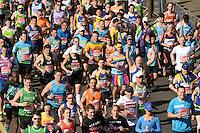 The mass of runners cross the start line at the Red Start of The Virgin Money London Marathon 2014. Sunday 13 April 2014<br /> <br /> Photo: Tom Lovelock/Virgin Money London Marathon<br /> <br /> media@london-marathon.co.uk