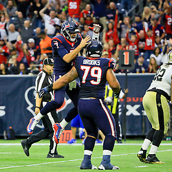 Nov 29, 2015; Houston, TX, USA; Houston Texans quarterback Brian Hoyer (7) celebrates with guard Brandon Brooks (79) after a touchdown against the New Orleans Saints during the third quarter of a game at NRG Stadium. The Texans defeated the Saints 24-6. Mandatory Credit: Derick E. Hingle-USA TODAY Sports