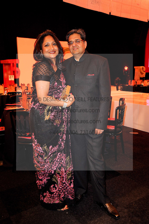 MR &amp; MRS PRMAOD AGARWAL at ARTiculate, Pratham UK Fundraising Gala held at The Old Billingsgate Market, City Of London on  11th September 2010 *** Local Caption *** Image free to use for 1 year from image capture date as long as image is used in context with story the image was taken.  If in doubt contact us - info@donfeatures.com<br /> MR &amp; MRS PRMAOD AGARWAL at ARTiculate, Pratham UK Fundraising Gala held at The Old Billingsgate Market, City Of London on  11th September 2010