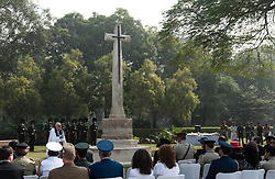 © Licensed to London News Pictures. 11/11/2012. Delhi, India. Reverend Ian Weathrall OBE leads a Remembrance Day ceremony today, held at Delhi War Cemetery, India.  Veterans were joined by over 400 people including representatives from other embassies and high commissions in New Delhi.  It was also attended by officials from the Indian Armed Services, with representation from over 100 serving personnel.   Remembrance Day (also known as Poppy Day or Armistice Day) is a memorial day observed in Commonwealth countries since the end of World War I to remember the members of their armed forces who have died in the line of duty. This day, or alternative dates, are also recognized as special days for war remembrances in many non-Commonwealth countries. Remembrance Day is observed on 11 November to recall the end of hostilities of World War I on that date in 1918.   Photo credit : Richard Isaac/LNP