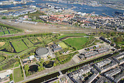 Nederland, Noord-Holland, Amsterdam, 09-04-2014;<br /> Cultuurpark Westergasfabriek en Westerpark op het voormalige  Westergasterrein langs Haarlemmerweg(niet in beeld). Spoor met treinen boven in beeld. Spaarndammerbuurt met Houthavens,  (Danzigerkade), IJ  en Amsterdam-Noord boven.<br /> Buildings of Culture park Westergasfabriek and the Westerpark on the former Westergasterrein (gasworks) along the railroad from Amsterdam Central station. View on the North of Amsterdam.<br /> luchtfoto (toeslag op standard tarieven);<br /> aerial photo (additional fee required);<br /> copyright foto/photo Siebe Swart