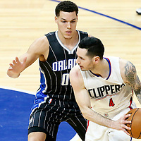 11 January 2017: Orlando Magic forward Aaron Gordon (00) defends on LA Clippers guard J.J. Redick (4) during the LA Clippers 105-96 victory over the Orlando Magic, at the Staples Center, Los Angeles, California, USA.