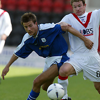 Airdrie v St Johnstone...07.08.04<br />Lee Hardy is held by Marvyn Wilson<br /><br />Picture by Graeme Hart.<br />Copyright Perthshire Picture Agency<br />Tel: 01738 623350  Mobile: 07990 594431