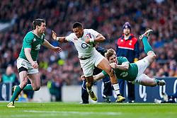 England Winger Anthony Watson is tackled by Ireland Fly-Half Jonathan Sexton and Winger Andrew Trimble - Mandatory byline: Rogan Thomson/JMP - 27/02/2016 - RUGBY UNION - Twickenham Stadium - London, England - England v Ireland - RBS 6 Nations 2016.
