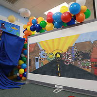 David Wilson of Google unveils the winning Google Doodle designed by Lawndale Elementary School student Morgan Tidwell.