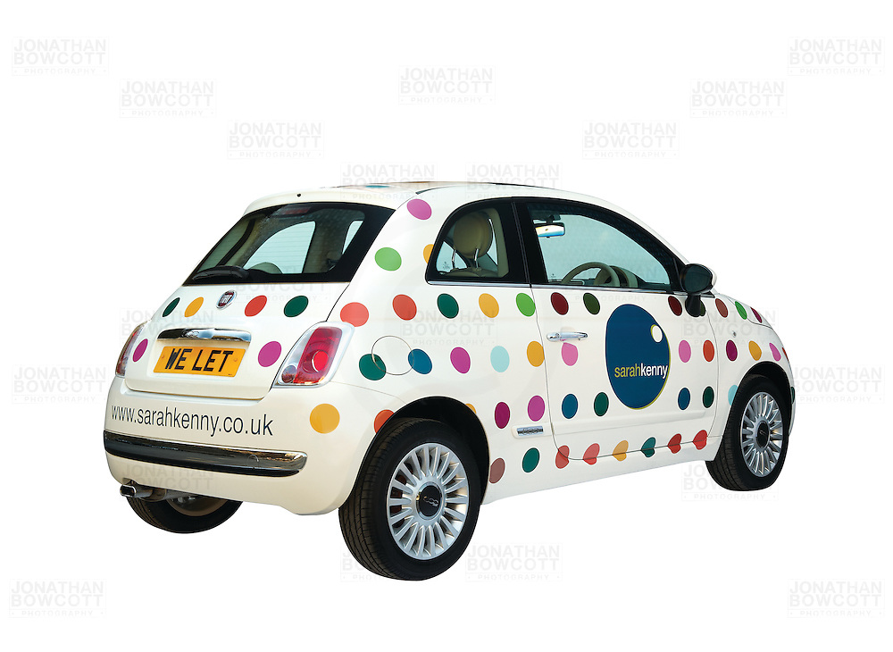 Fiat 500 with the corporate logo of Sarah Kenny a Bristol based lettings agency. Photographed against a white background in a garden near Bristol