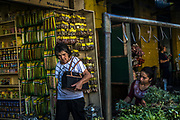 A woman looks on as a herb seller separates medicinal plants in Asuncion, Paraguay, Monday, Nov.13, 2017. Paraguay today is trying to promote a positive image of Guaraní language, the native oral language that survived centuries of subjugation rendering it as a second class idiom in the minds of many Paraguayans that associated it with poverty, rurality, ignorance and illiteracy. (Dado Galdieri for The New York Times)