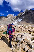 Backpacker on Bishop Pass, Kings Canyon National Park, California USA