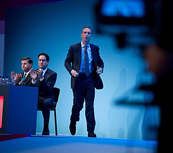 © London News Pictures. 23/09/2013 . Brighton, UK.  Leader of the Labour Party ED MILIBAND (left) and Shadow Secretary of State for Defence JIM MURPHY (centre) on stage on day two of the Labour Party Annual Conference in Brighton. Photo credit : Ben Cawthra/LNP