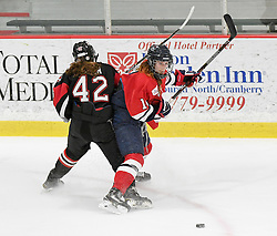 MOON TOWNSHIP, PA - SEPTEMBER 14:  Mikaela Lowater #14 of the Robert Morris Colonials battles for the puck with Claire Dalton #42 of the Toronto Jr. Aeros during the game at the 84 Lumber Arena on September 23, 2016 in Moon Township, Pennsylvania. (Photo by Justin Berl)
