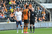 Chuba Akpom  yellow card during the Sky Bet Championship match between Hull City and Preston North End at the KC Stadium, Kingston upon Hull, England on 29 August 2015. Photo by Ian Lyall.