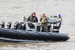 © Licensed to London News Pictures. 23/10/2018. London, UK. Royal Marines in a RIB during a rehearsal for a display tomorrow when the Royal Marines and Royal Netherlands Marines will stage a joint on water capability demonstration with blank ammunition. As part of the Dutch state visit, King Willem-Alexander and Queen Máxima will attend the Dutch ship HNLMS Zeeland, which is anchored next to HMS Belfast. They will join The Duke of Kent on board and will be given a 10 minute display of the Royal Marines and Royal Netherlands Marines staging a joint on water capability demonstration.Photo credit: Vickie Flores/LNP