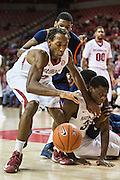 FAYETTEVILLE, AR - DECEMBER 19:  Michael Qualls #24 of the Arkansas Razorbacks goes after a loose ball during a game against the UT Martin Skyhawks at Bud Walton Arena on December 19, 2013 in Fayetteville, Arkansas.  The Razorbacks defeated the Skyhawks 102-56.  (Photo by Wesley Hitt/Getty Images) *** Local Caption *** Michael Qualls