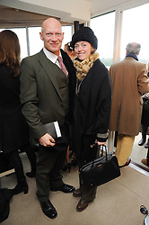 CAMILLA RUTHERFORD and DOMINIC BURNS at the Hennessy Gold Cup 2010 at Newbury Racecourse, Berkshire on 27th November 2010.