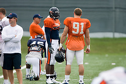 Virginia Cavaliers LB Clint Sintim (51) talks with Virginia Cavaliers DE Chris Long (91)..The Virginia Cavaliers football team held their first open practice of the 2007 season on the practice fields next to the University of Virginia's McCue Center in Charlottesville, VA on August 10, 2007.
