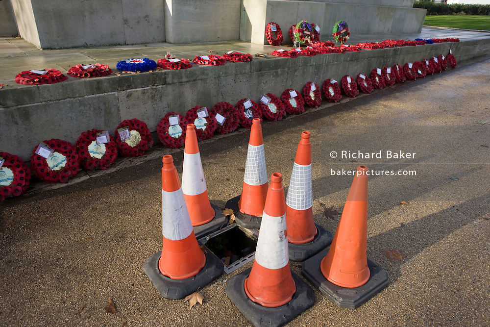 Armistice wreaths and traffic cones at the Royal Artillery war memorial at Hyde Park Corner.