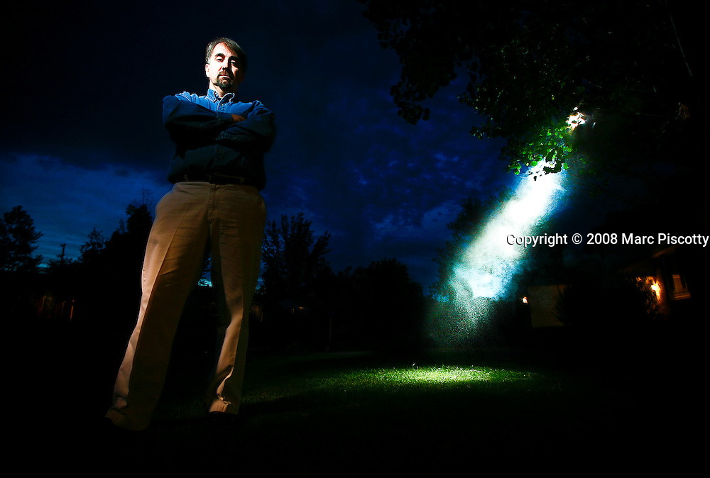 """SHOT 5/23/08 8:51:30 PM - Portraits of Stan Romanek, 45, of Loveland, Co. who claims to have experienced and even documented more than 100 extraterrestrial encounters in his lifetime. Since December 2000 Romanek said he has been abducted numerous times and been the conduit for complex mathematical equations that he doesn't even understand. Romanek said he understands that there are skeptics out there and added, """"I'm not the only one to go through this and most people don't want to talk about it because of the ridicule, I just want to be taken seriously"""". He has attempted to use mainstream science to study the experiences and a non-fiction book and documentary are in the works about his life. .(Photo by Marc Piscotty / © 2008)"""