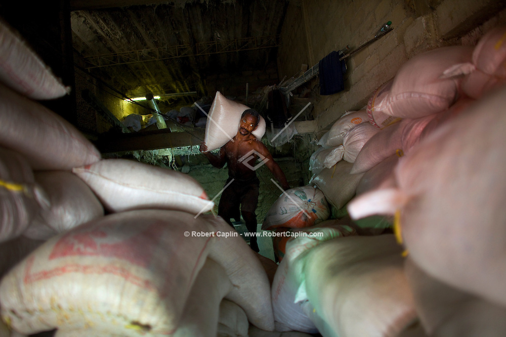 A rice vendor at Basurto market near Cartagena, Colombia...Photo by Robert Caplin.