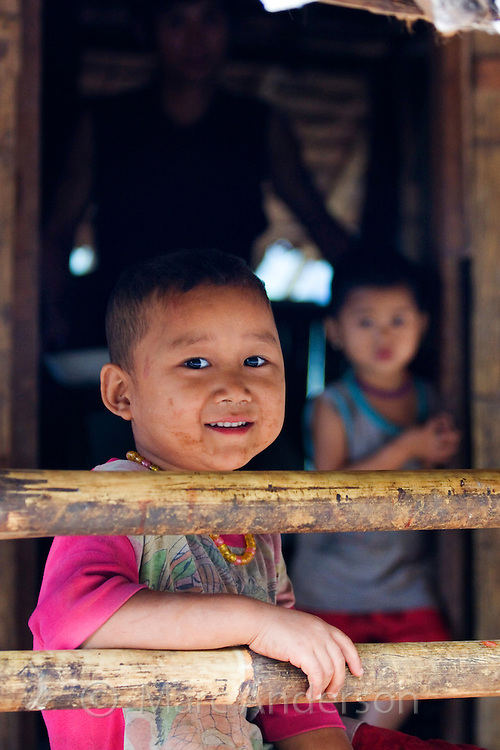 Children in a bamboo house,  Mae Sam Laep, Mae Hong Son Province, Thailand
