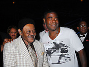 "Legendary musician Antoine Dominque ""Fats Domino"" greets comedian Tracey Morgan as he walks off stage  after he performed in New Orleans Saturday May 30,2009 as part of the Domino Effect Benefit concert which also featured B.B. King and Chuck Berry. Domino Effect Benefit Concert legendary performers gather in New Orleans at the Arena to raise funds and awarness for hurricane Katrina rebuilding for Fats Domino the Tipatina Foundation and the Drew Brees' foundation. Photo©Suzi Altman ALL IMAGES ©SUZI ALTMAN. IMAGES ARE NOT PUBLIC DOMAIN. CALL OR EMAIL FOR LICENSE, USE, OR TO PURCHASE PRINTS 601-668-9611 OR EMAIL SUZISNAPS@AOL.COMPhoto©Suzi Altman"