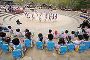 Korean Folk Village. School kids watching traditional farmers' dance.