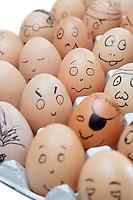 Anthropomorphic brown eggs arranged in carton against white background