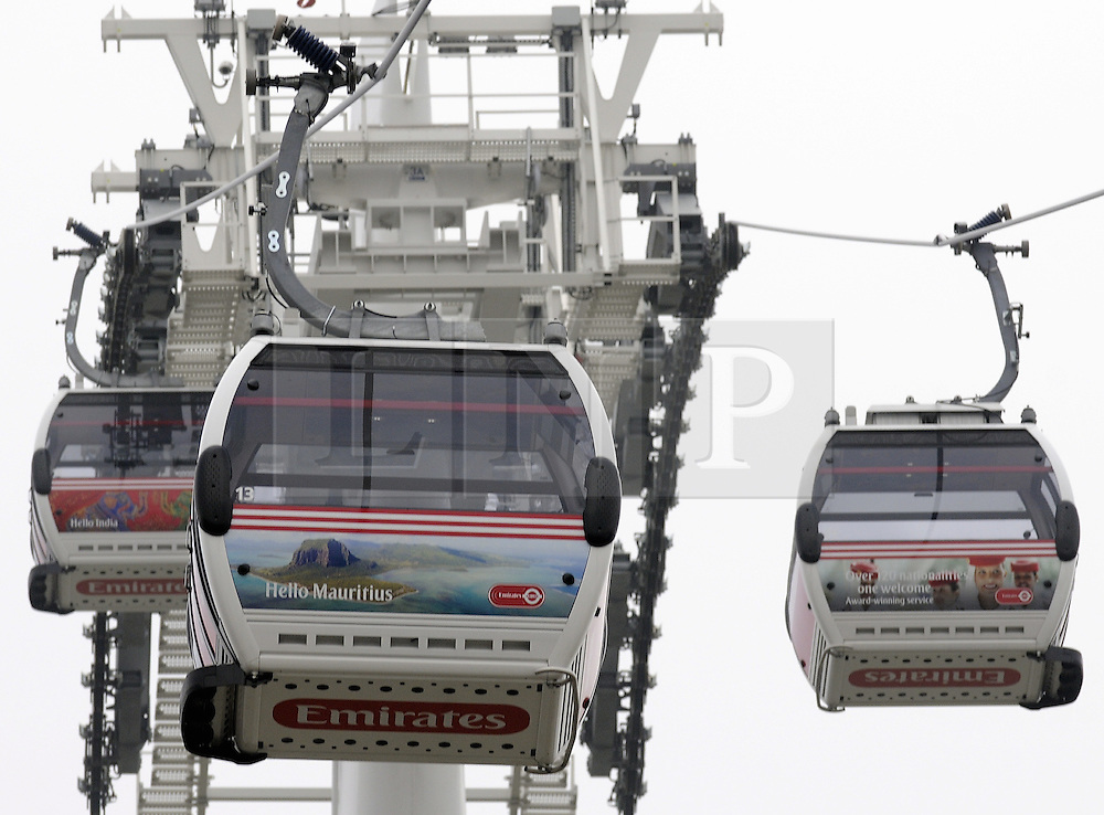 © Licensed to London News Pictures. 11/01/2013.Passenger numbers are very low on the Emirates Greenwich Peninsula Airline cable car with more members of staff on duty at the entrance than customers..  The cable car has a capacity to carry up to 2,500 people per hour in each direction, but recent passenger numbers have been less than 230 an hour..the airline cable car connects the Greenwich Peninsula on the south of the Thames with the Royal Docks on the north side, providing a link between the O2 in Greenwich and the Excel exhibition centre.  The Dubai-based Emirates airline agreed a £36m, 10-year sponsorship deal for the cable car in October 2011..Photo credit : Grant Falvey/LNP
