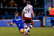 AFC Wimbledon defender Jonathan Meades (3) tackles Bradford City defender Anthony McMahon (29)  during the EFL Sky Bet League 1 match between AFC Wimbledon and Bradford City at the Cherry Red Records Stadium, Kingston, England on 23 December 2017. Photo by Simon Davies.