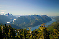 Tahsis inlet and the surrounding terrain of Vancouver Island lies spread out for miles around.  Tahsis, Vancouver Island, British Columbia, Canada.