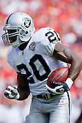 KANSAS CITY, MO - SEPTEMBER 20:   Darren McFadden #20 of the Oakland Raiders runs with the ball against the Kansas City Chiefs at Arrowhead Stadium on September 20, 2009 in Kansas City, Missouri.  The Raiders defeated the Chiefs 13-10.  (Photo by Wesley Hitt/Getty Images) *** Local Caption *** Darren McFadden