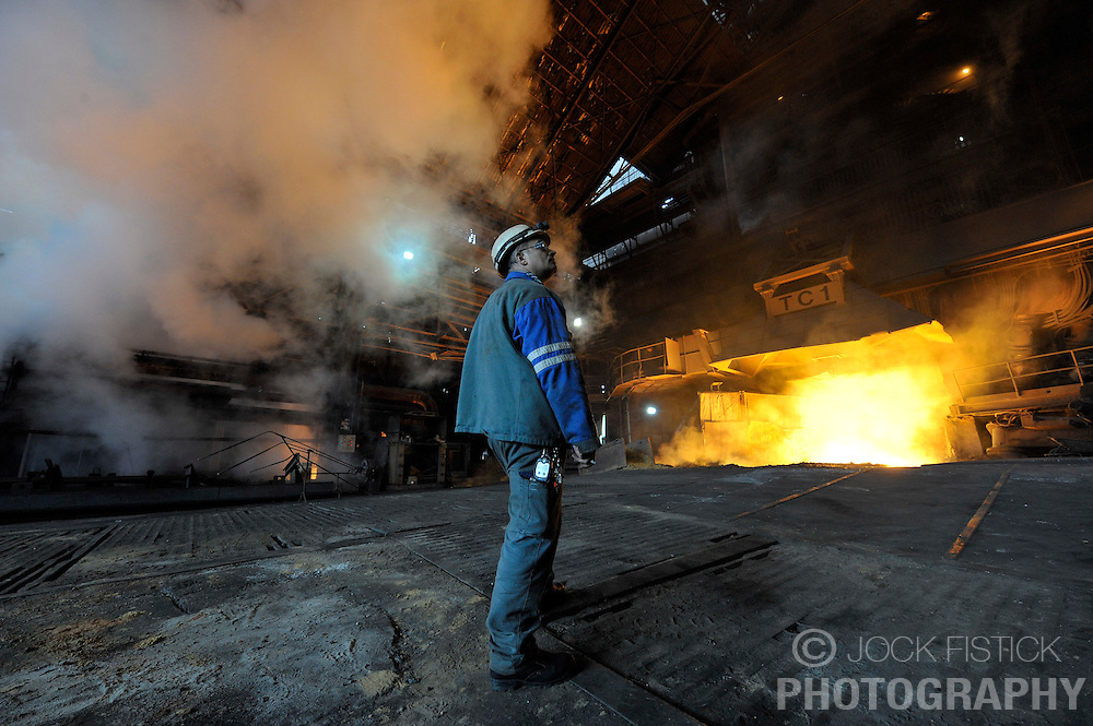 An Arcelor-Mittal employee, monitors blast furnace B, at the Ougree facility near Liege, Belgium, Monday, Feb. 9, 2009. (Photo © Jock Fistick)