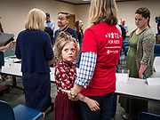 "24 MAY 2019 - WEST DES MOINES, IOWA: JEN STATLER, right, hugs her granddaughter, MYLAH STATLER, 7, while they wait to talk to US Senator KIRSTEN GILLIBRAND (D-NY), left, after Gillibrand's forum on family rights in the West Des Moines Public Library. Gillibrand unveiled her ""Family Bill of Rights"" during a forum in West Des Moines. The New York Senator has made family health and rights a centerpiece of her campaign. She is touring Iowa this week to support her candidacy to be the Democratic nominee for the US Presidency. Iowa traditionally hosts the the first selection event of the presidential election cycle. The Iowa Caucuses will be on Feb. 3, 2020.           PHOTO BY JACK KURTZ"