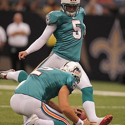 2008 August 28: Kicker, Dan Carpenter (5) kicks a field goal for the Miami Dolphins during the first half against the New Orleans Saints in a preseason match up at the Louisiana Superdome in New Orleans, LA.