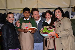 Victoria Pendleton, Shahanur Rahman (10) from Rotherfield Primary School, Jamie Oliver, Ellie May Farrelly (10) from Rotherfield Primary School,  Kirstie Allsopp,  during Jamie Oliver 's street party Food Revolution Day.  Kirstie Allsopp, Victoria Pendleton, join Oliver as he hosts street party outside his Shoreditch restaurant Fifteen, to celebrate Food Revolution Day, London, United Kingdom, May 17, 2013. Photo by: Nils Jorgensen / i-Images
