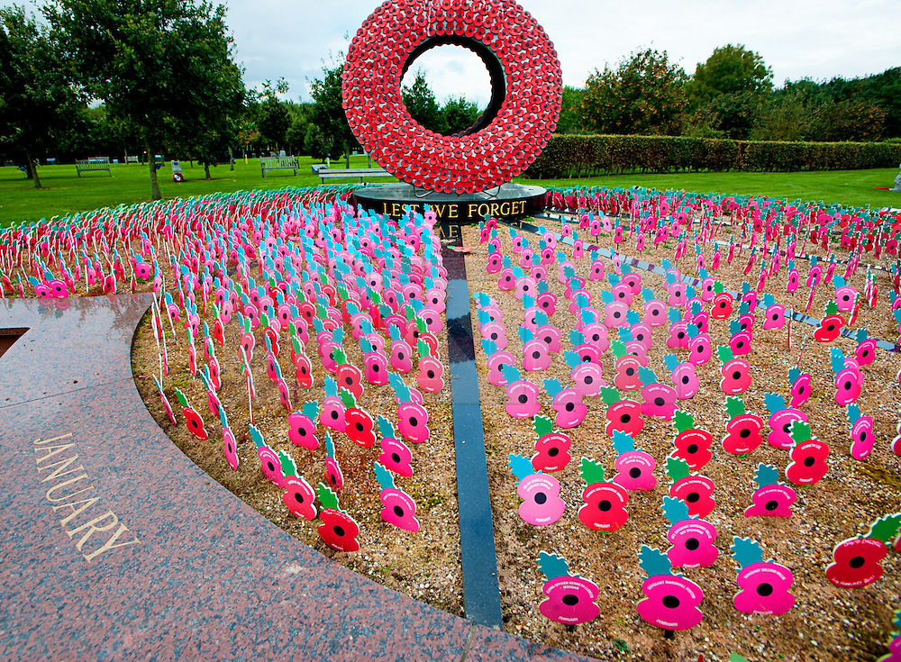 """© Licensed to London News Pictures. 17/10/2016. Alrewas  Staffordshire England  <br /> The Royal British Legion Never Forget Memorial ,The memorial features a giant wreath around which poppies, inscribed with individual names and dates, can be planted as a permanent tribute.""""Never Forget"""" is the shape of a poppy whose petals are flower beds for thousands of small wooden poppies to be planted, <br /> Rob Leyland/LNP"""