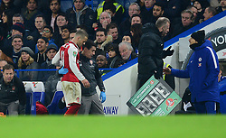 Jack Wilshere of Arsenal is taken down the tunnel by a member off medical team after coming off the pitch. - Mandatory by-line: Alex James/JMP - 10/01/2018 - FOOTBALL - Stamford Bridge - London, England - Chelsea v Arsenal - Carabao Cup semi-final first leg