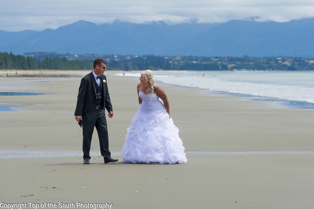 Donna & Chris chose Rabbit Island, Nelson, New Zealand for their wedding day and although the weather was not the beautiful weather we have had lately, the Bride and Groom looked fantastic and there was definitely love in the air.