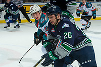 KELOWNA, CANADA - FEBRUARY 23: Nolan Volcan #26 of the Seattle Thunderbirds is checked by Kole Lind #16 of the Kelowna Rockets  on February 23, 2018 at Prospera Place in Kelowna, British Columbia, Canada.  (Photo by Marissa Baecker/Shoot the Breeze)  *** Local Caption ***