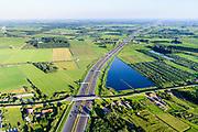 Nederland, Gelderland, Gemeente Geldermalsen, 23-08-2016; Diefdijk, doorsneden door de A2. De nieuwe kering met brug en kazemat is ontworpen door UN studio, de coupure kan bij extreem hoog water afgesloten worden door betonnen balken. De Diefdijk is een binnendijk en oorspronkelijk aangelegd om de Alblasserwaard en de Vijfherenlanden tegen wateroverlast uit de Betuwe te beschermen. Daarnaast maakt de dijk onderdeel uit van Nieuwe Hollandse Waterlinie.<br /> Diefdijk, intersected by A2. The cut can be closed with concrete beams in case of extremely high water. The inner dike was originally built to protect the polders Alblasserwaard and Vijfherenlanden against flooding from the Betuwe. <br /> aerial photo (additional fee required); <br /> luchtfoto (toeslag op standard tarieven);<br /> copyright foto/photo Siebe Swart