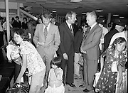 Vietnamese Refugees Arrive In Ireland.   (M85)..1979..09.08.1979..08.09.1979..9th August 1979..As part of an UNHCR initiative, Ireland agreed to take some of the Vietnamese (boat people) refugees into the country. A temporary refugee centre has been set up in the grounds of Blanchardstown Hospital to accomodate the families, from where they will be assimilated into the community..Image shows the Minister, Michael O'Kennedy, and his officials with the Vietnamese refugees at Dublin Airport.