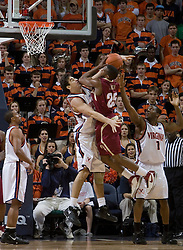 Florida State Seminoles guard Jason Rich (25) is fouled while shooting by Virginia Cavaliers forward/center Ryan Pettinella (34).  The Virginia Cavaliers Men's Basketball Team defeated the Florida State Seminoles 73-70 at the John Paul Jones Arena in Charlottesville, VA on February 17, 2007.