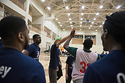 Students, faculty and staff participate in the first MLK Jr. Charity Basketball game at Ping Center on Jan. 24, 2019. Photo by Hannah Ruhoff