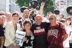 "© Licensed to London News Pictures. 31/08/2013. London, UK. Lorraine Etherington (2L), Lorraine Salvage (3L) and Mark Peterson (4L), sister, cousin and brother of of prisoner Charles Bronson, are seen with other friends and relatives before handing in a petition for his release to Number 10 Downing Street in London today (31/08/2013). Often referred to in the British press as the ""most violent prisoner in Britain"", Bronson is currently being held on a life sentence in Wakefield High-Security Prison. Photo credit: Matt Cetti-Roberts/LNP"